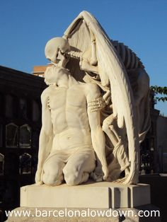 El Beso de la Muerte -- Close up photo of the kiss of death statue in the cemetery of Poblenou, Barcelona