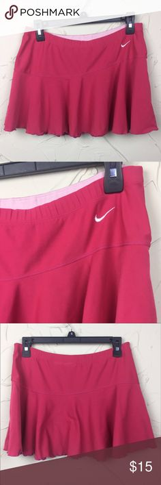 """Nike Fit Dry Tennis Skirt Cute pink tennis skirt from Nike. It has a scalloped hem line and seam that curves around the front. Elastic waistband. Only flaw is 2 spots on the front waistband (see last pic). It is not very noticeable.  15"""" across the waist. 12"""" long. Nike Skirts"""