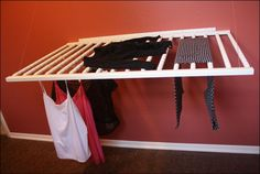 10 DIY Laundry Drying Racks For Small Spaces repurposed crib drying rack Diy Clothes Drying Rack, Baby Clothes Storage, Old Baby Cribs, Old Cribs, Wall Mounted Drying Rack, Old Wooden Ladders, Drying Rack Laundry, Laundry Design, Small Space Storage