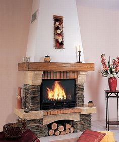 emma-wood-fireplace_1333.jpg (550×660) Like the way this tapers up and is drywall above mantel. Would change stone facing around actual fireplace and hearth