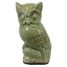 Weathered ceramic owl statuette.  Product: StatuetteConstruction Material: CeramicColor: Green