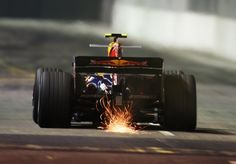 Torro Rosso car bottoming out at the Singapore night race.