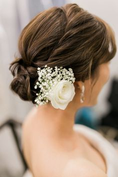 Elegant bridal updo with white rose and baby's breath // Having first met when Gary was a sous chef and Lynette a patisserie chef (and now owners of grill/bar The Carving Board), the pair translated their love for food into their home engagement shoot and wedding at Tamarind Hill Singapore beautifully.