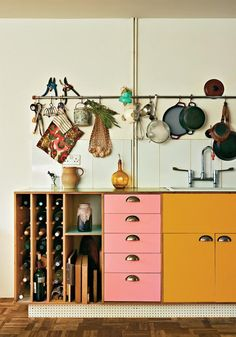 A colorful kitchen with only the essentials (including ample wine storage).
