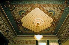 Dramatic ceiling decor gives rooms a period or personal dimension