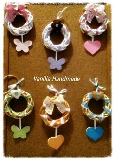 Garlands with ceramic decorations and pannolenci by Vanilla Handmade https://m.facebook.com/vanillahandmade/