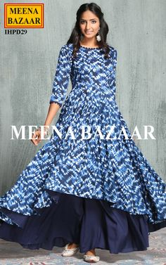 Fashionable women will surely like to step out in style wearing this Blue coloured Anarkali with kalidar Sharara. A must-have in your ethnic wear collection, this suit set features shibori dye asymmetrical hemline.