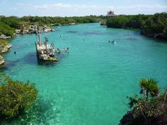 Xel-Ha, a natural aquarium park where you can go tubing, snorkel, Snuba, Sea Trek, or swim with dolphins is south of Akumal, Cancun, Riveria Maya, Mexico.  Incredibly beautiful!   Go to http://www.yourtravelvideos.com/view.php?view=121062 or click on photo for video and more on this site.
