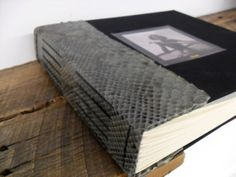 This is a hardcover long and link stitch book I did for a client named Lisa. The spine of the book is made with beautiful piece of python, and black iris book cloth for the covers. I in-laid a photo of her mother on the cover and hot stamped her mothers nickname onto the photo.