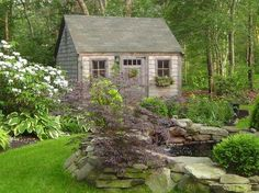 Little cottage in the wood with pond.