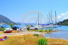 Lefkada island sailboats and parked car at coast, summer nature view,Nydri coast,Greece