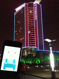 A Sweet neon building.  Dingli International Hotel / Huai'an, China