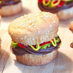 Burgers for dessert! Cupcake cheese burgers. Use chocolate frosting for the patty.