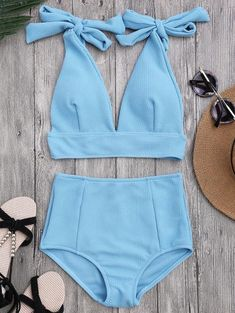 Textured bralette bikini top featuring triangular shaped cups with ajusted shoulder bowknot tie, plunging collar detailing. High rise bikini bottoms featuring a
