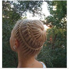 looks like half a french braid all the way around (limited hair); ponytail into a french w/ remaining hair; tuck in. gotta try this!