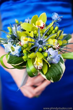 Hosta, orchid, thistle, hypericum and delphinium bouquet. Photo by Phindy Studios