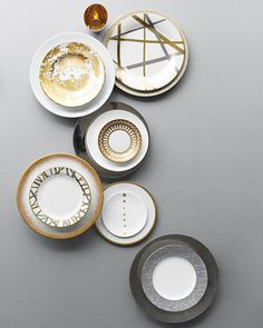 Mix in Metallic China Patterns    Make like an alchemist and turn your table into a vision of white, gold, and silver.