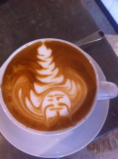He pulls that hat off better than me. #latteart #coffee