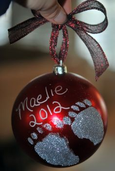 Holiday ornament...add a child's footprint or handprint along with their name and age to an ornament...make a separate ornament for each child    Maeliefinal 500x746 DIY Holiday Footprint Ornaments: A Perfect Holiday Gift!