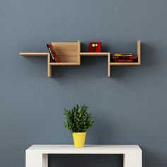 Sleek and Elegant, the Decortie Rako Wall Shelf features a stunning design that would look fabulous in a contemporary interior. Featuring a unique asymmetric design, this shelf is sure to add a creative edge to your space. h: 13.4 w: 45.3 d: 8.6