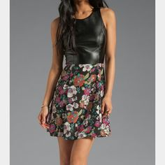 Eight sixty Alice vegan leather floral dress Zips in the back. Vegan leather front and polyester/rayon/ spandex in the back. Polyester bottom. Sweet with a bit of an edge. Love this dress! Eight Sixty Dresses
