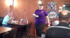 Waitress delivering food to customers at the Smok-Shak Restaurant in Ingersoll, OK. #barbecue
