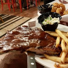 """@Morganfields sticky bone tender and hearty pork ribs grilled with BBQ sauce. Another """"in"""" thing in KK. Big portion but service is slow. -obviously non halal"""