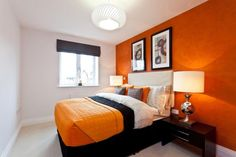photo of bright colourful modern simple beige orange white quilted linden homes bedroom with artwork feature wall
