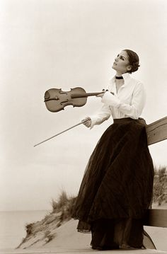 I have a violin. The lady in the picture looks like she she plays so beautifully, and I want to play as beautiful as she looks like she does... that is my wish