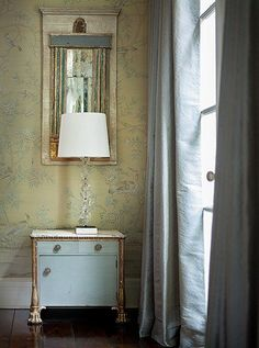 """Suzanne chose this custom-colored de Gournay wallpaper for its soft sisal hue—""""almost a no-color,"""" she says. Silk curtains in platinum blue tie in visually to the butler's pantry."""