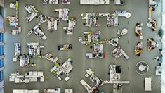 This image by German photographer Menno Aden offers a view down from the ceiling onto an empty pharmaceutical laboratory.