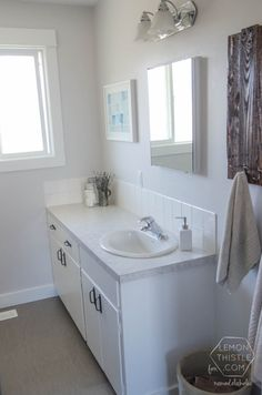 Bathroom Contemporary White Diy Bathroom Remodel With White Painted Wall And Wall Mirror Under Classic Lamps Also Bathroom Cabinet With Storage And Sink Faucet Tips on DIY Bathroom Remodel