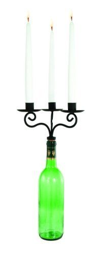 Triple Wine Bottle Taper Candle Holder by Ganz. $14.95. Blackened Iron Triple Candle Holder Wine Bottle Topper. Thoughtful gift for Wine Lovers. Insert Cork into empty wine bottle. Unique Candle Holders. (7-2/1 inch W x 5-5/8 inch H) To be used on empty Wine Bottles