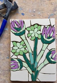 Another special mosaic commission in progress - this is in memory of a clients father who loved thistles. It is for outside with a metal post attached to have at his resting place. Fx