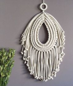 Beautiful macrame wall hanging. BOHO, bohemian style. Modern macrame. 100% natural cotton cord  Size: total length: 50 cm (19,7'')  The same wall hanging in black: https://www.etsy.com/listing/465934324/black-wall-art-macrame-wall-hanging?ref=shop_home_active_1  100% handmade  We ship WORLDWIDE! Shipping to Europe normally takes 5-8 days, to US, Canada – 7-15 days. Please feel free to contact me if you have any questions.  Thank you for visiting MOX macrame! To s...