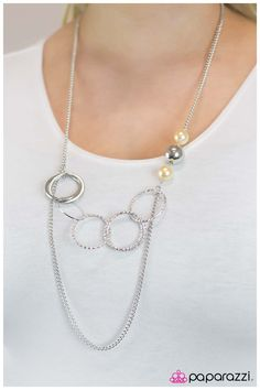 Expressionist $5.00 Product Description An abstract array of twisted sparkling hoops, smooth rings, and slim wire ovals interlock into a contemporary design. Accented with two yellow pearls and a silver bead, the double chain arrangement creates an elegant elongating effect. Features an adjustable clasp closure. Sold as one individual necklace. Features one pair of matching earrings.
