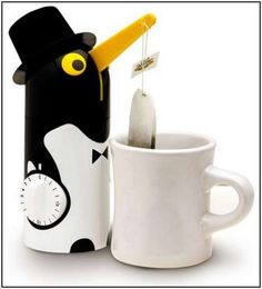 This little guy will help you make the perfect cup of tea... and he'd also be the perfect gift for my mother, who forgets she poured tea and lets it get too strong all the time.