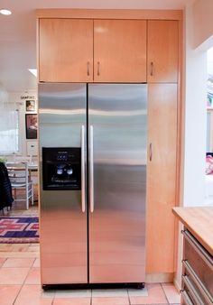 Kitchen Tour: Cissy and Richard's Relaxed Green Kitchen fridge w/ narrow pullout storage to the right