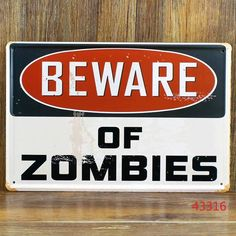"""Beware of Zombies"" Metal Plaque Sign The Walker Store    http://thewalkerstore.com/metal-plaque-sign/"