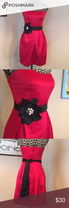 Strapless red formal Excellent condition. Bright red strapless dress with black floral belt. Bodice is 9 inches long. Skirt is 18. 28 waist. Belt is a ribbon that ties around Trixxi Dresses Mini