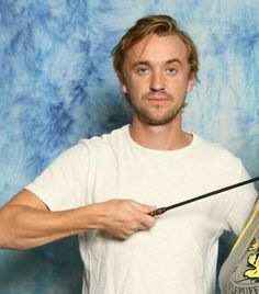 Tom with something Hufflepuff! My favorite thing, since that's my house. :D
