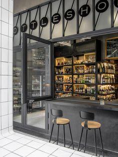 Bob's Select bar decorated with liquor lettering Architectural studio Designreserve have created a liquor store-cum-bar in Sanlitum, Beijing Cafe Bar, Wine Shop Interior, Bar Interior Design, Cafe Design, Wc Container, Alcohol Shop, Liquor Shop, Liquor Bar, Beer Bar