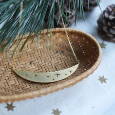 Starry map, pine composition and Star Dust necklace composition by Shlomit Ofir