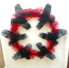 Murder of crows using tulle and wire.