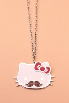 Mustaches are all the rage!! Look extra cute and fashionable in this Hello Kitty Necklace! You can doll up any outfit and its perfect for any occasion! It definitely is a must have!Featuring a high polished metal hello kitty pendent with a mustache face