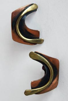 "Art Smith, Earrings copper and brass, ca. 1950's. One of the leading modernist jewelers of the mid-twentieth century, Smith trained at Cooper Union. Inspired by surrealism, biomorphicism, and primitivism, Art Smith's jewelry is dynamic in its size and form. Although sometimes massive in scale, his jewelry remains lightweight and wearable. See ""From the Village to Vogue: The Modernist Jewelry of Art Smith""."