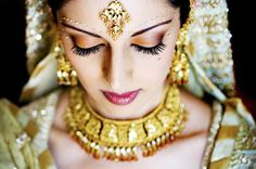 gold copper pakistani indian wedding. makeup and jewelry.