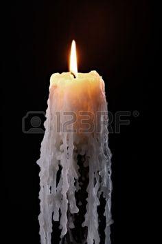 Single candle flame on black background Stock Photo