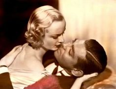 gable-and-lombard-kiss;  Carole Lombard was only 33 when she died in a plane crash.  All that was ever found of her were her earrings.