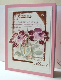 As I'm looking for different effects on my stamps, I am using distress markers.  The flowers are Hero Arts, cut out and mounted.